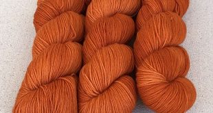 """Persimmon"" hand dyed yarn. Tonal reddish orange. Base: ExtraFine is 4ply, very ..."